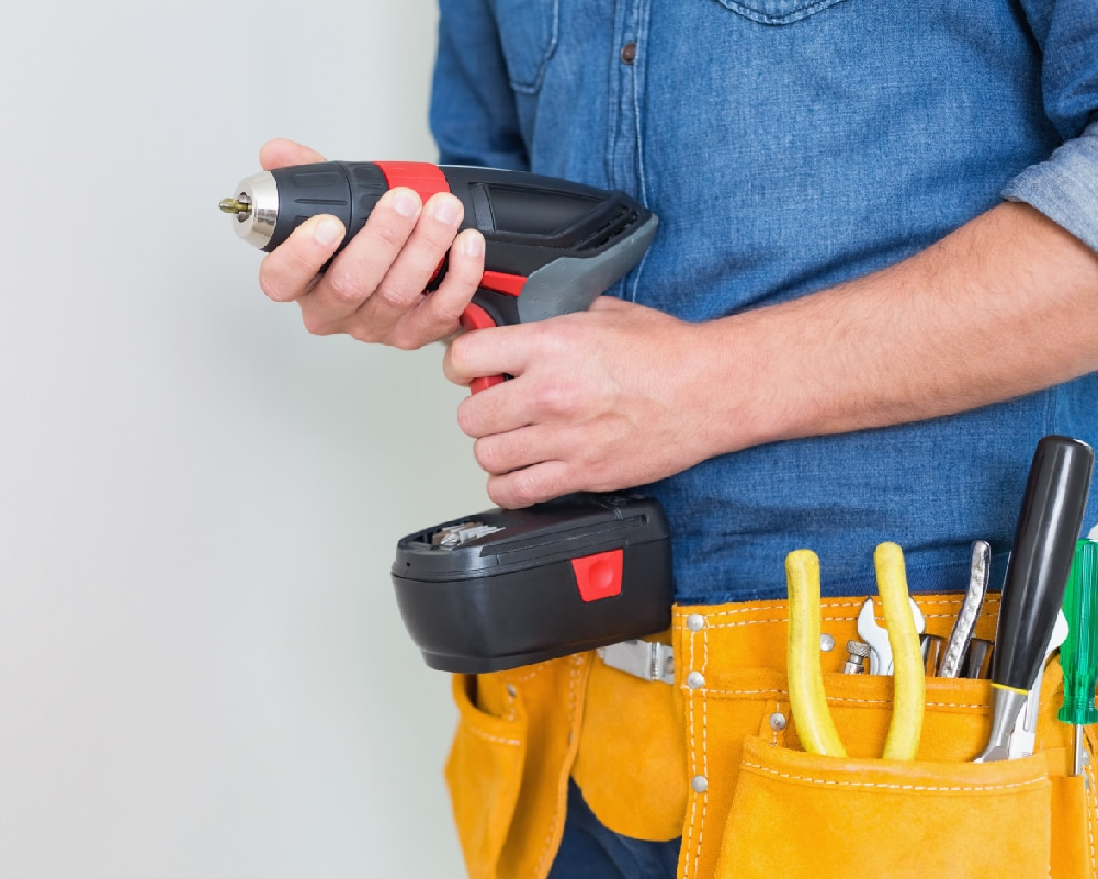 Man Holding a Power Drill