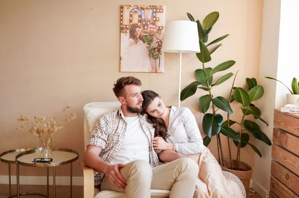Couple sitting down on a chair