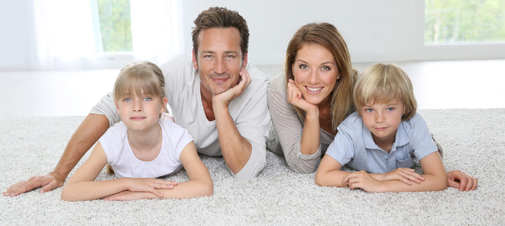 Family of four on a carpet