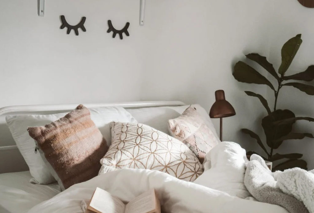 Brown and white pillows on a bed